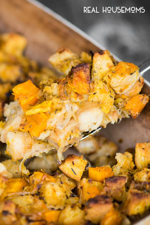 A big spoonful of Butternut Squash and Leek Stuffing ready for serving