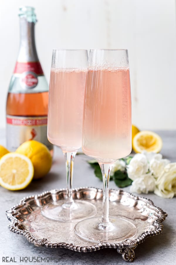 This Champagne Lemonade is the perfect light cocktail for your holiday parties! Serve it up at brunch, bridal showers, or New Year's Eve! It's easy to make too!