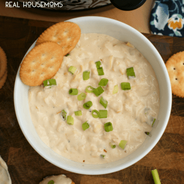 This cheesy CROCK POT SHRIMP AND ARTICHOKE DIP is hot, creamy, and full of tender shrimp. It's sure to be the hit of your next get-together!