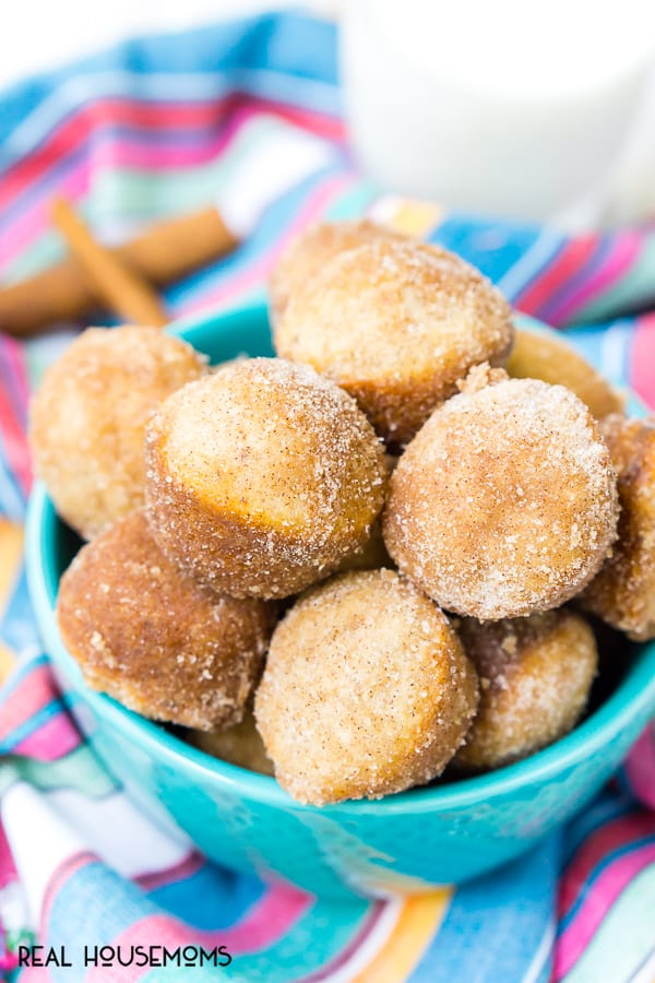 Cinnamon Sugar Donut Muffins piled into a bowl and served with milk
