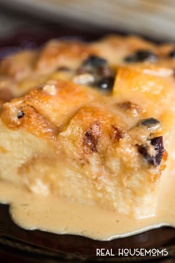 Close up of Classic Bread Pudding slice served on a plate and doused in Vanilla Caramel Sauce