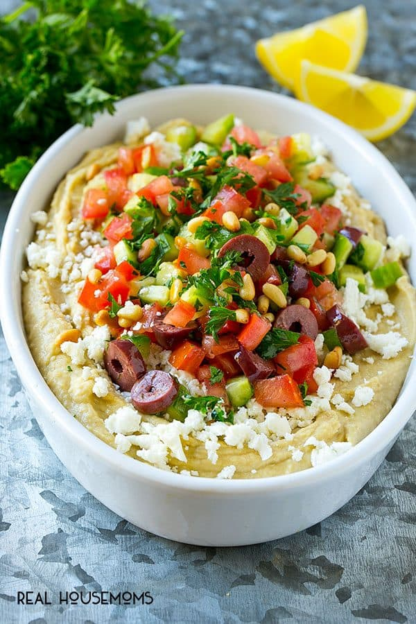 This easy Greek Layered Dip is the perfect 10-minute party appetizer that's a total crowd pleaser. Serve this dip with pita chips or fresh veggie and watch it disappear!