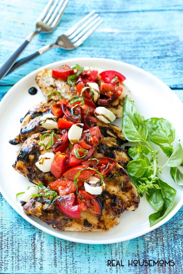 This GRILLED CAPRESE CHICKEN is the perfect way to showcase ripe summer tomatoes! It's an easy and flavorful dinner that's ready in 20 minutes!