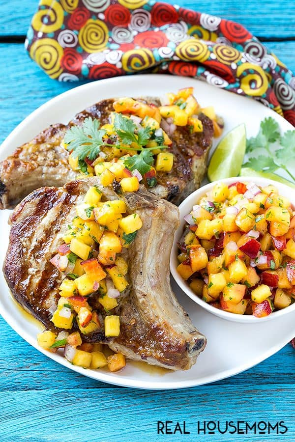 These quick and easy GRILLED PORK CHOPS WITH PEACH SALSA are the perfect main course for a summer barbecue. The peach salsa takes just minutes to make and elevates these pork chops to company worthy status!