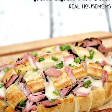 HAM AND SWISS PULL APART BREAD is made with cheesy, gooey Swiss cheese, Virginia ham, and takes less than 30 minutes to make. Perfect for noshing in a hurry!