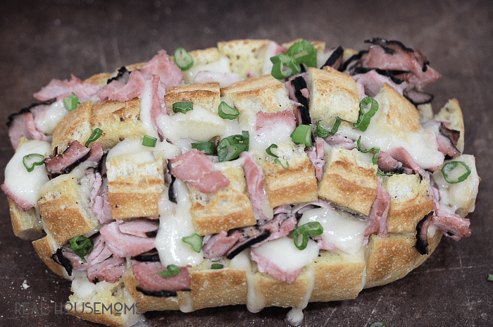 Looking to nosh is a hurry? This pull apart bread is made with cheesy, gooey swiss, Virginia ham, and takes less than 30 minutes to make!