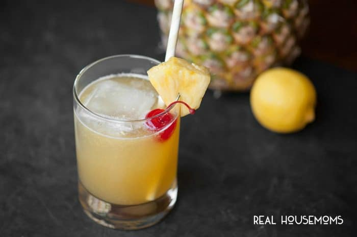 This tart HAWAIIAN STONE SOUR, made with whiskey and pineapple juice, will make your mouth pucker while you daydream about relaxing on a tropical beach!