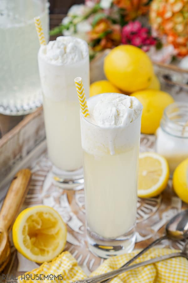 Homemade Lemonade Floats served with straws and a little ice cream dripping down the side of the glass