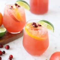 If you are going to be entertaining this holiday season, make sure to mix up a batch of this Orange Cranberry Holiday Party Punch!