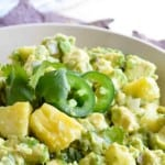 PINEAPPLE GUACAMOLE is a flavor combo that seems strange but works so well! Creamy avocado with sweet and tangy pineapple chunks makes the perfect summertime snack!