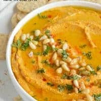 Pumpkin Hummus needs to be on your holiday menu! This hummus recipe is super creamy, full of flavor and great for feeding a hungry crowd!