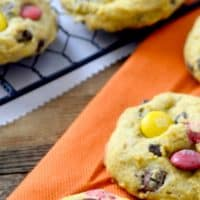 PUMPKIN M&M CHOCOLATE CHIP COOKIES are the perfect fall bite! Pumpkin spice and chocolate meld together into cookie bliss!