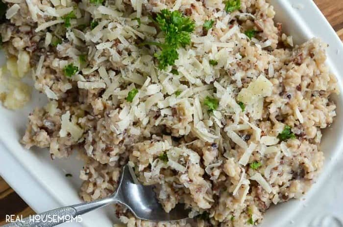 If you are looking for a side dish that is easy, filling, and bursting with flavor; this ROASTED GARLIC CHEESY RICE is what you need!