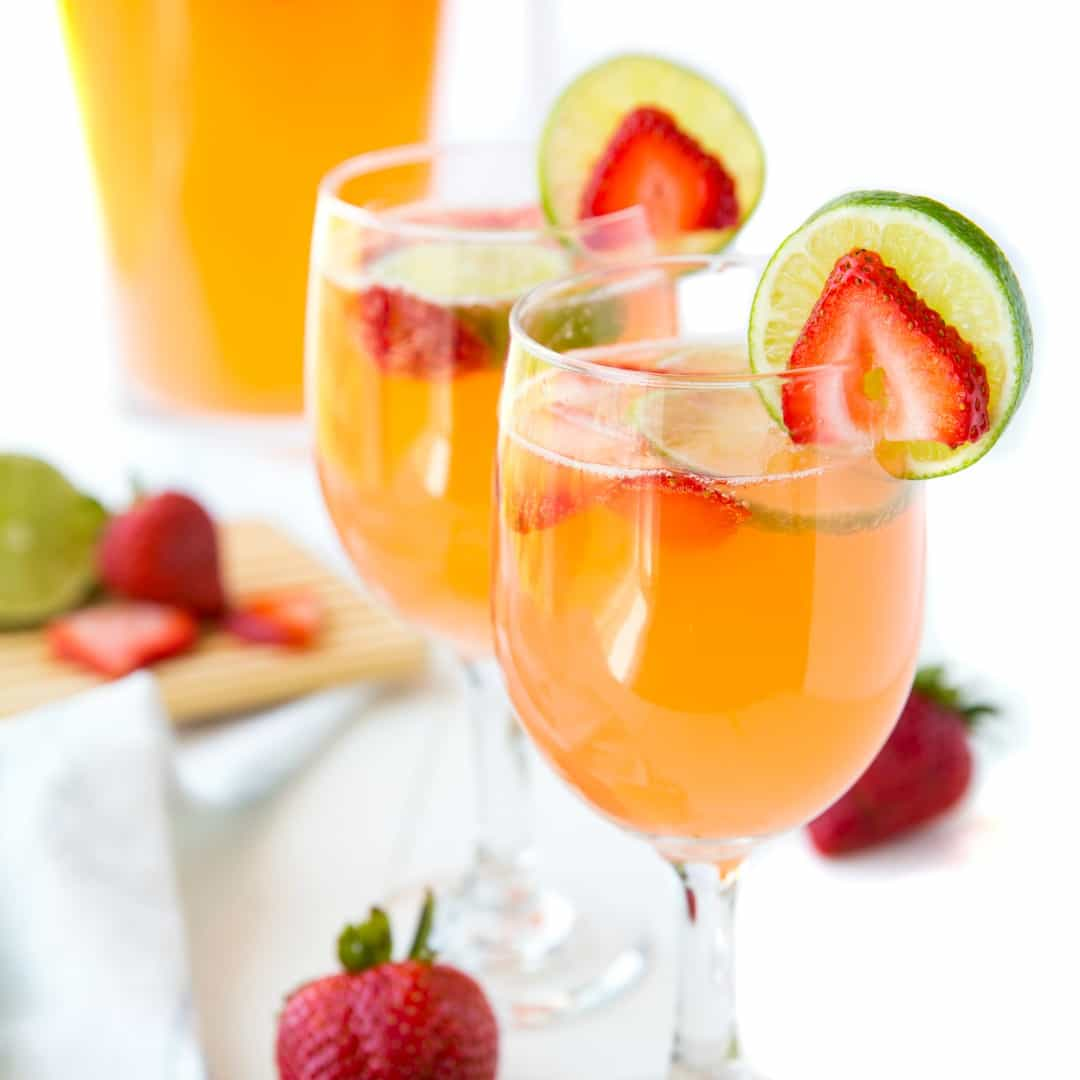 Strawberry & Lime Moscato Punch has the sweet flavor of your favorite wine with a great strawberry lime kick! This is an easy cocktail recipe, perfect for entertaining!