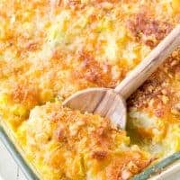 Squash casserole in a baking dish with a spoon